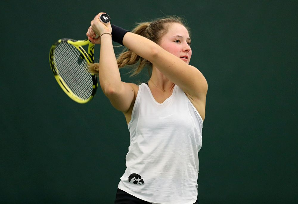 Iowa's Danielle Burich returns a shot during her singles match at the Hawkeye Tennis and Recreation Complex in Iowa City on Sunday, February 23, 2020. (Stephen Mally/hawkeyesports.com)