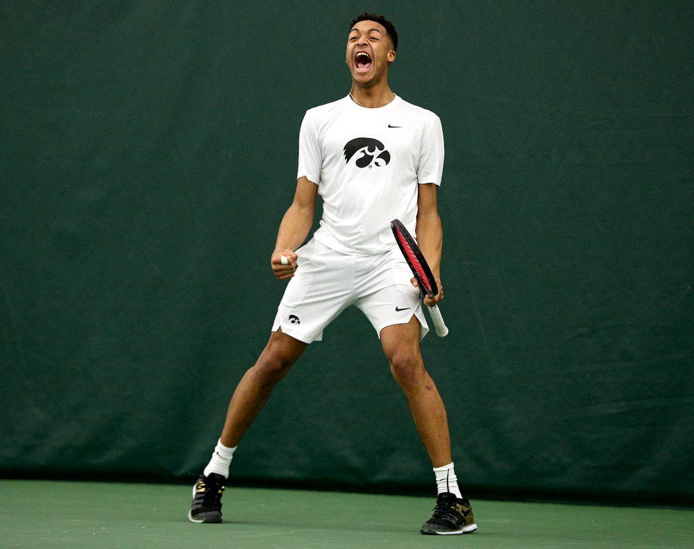 Iowa's Oliver Okonkwo celebrates during his singles match at the Hawkeye Tennis and Recreation Complex in Iowa City on Sunday, February 16, 2020. (Stephen Mally/hawkeyesports.com)
