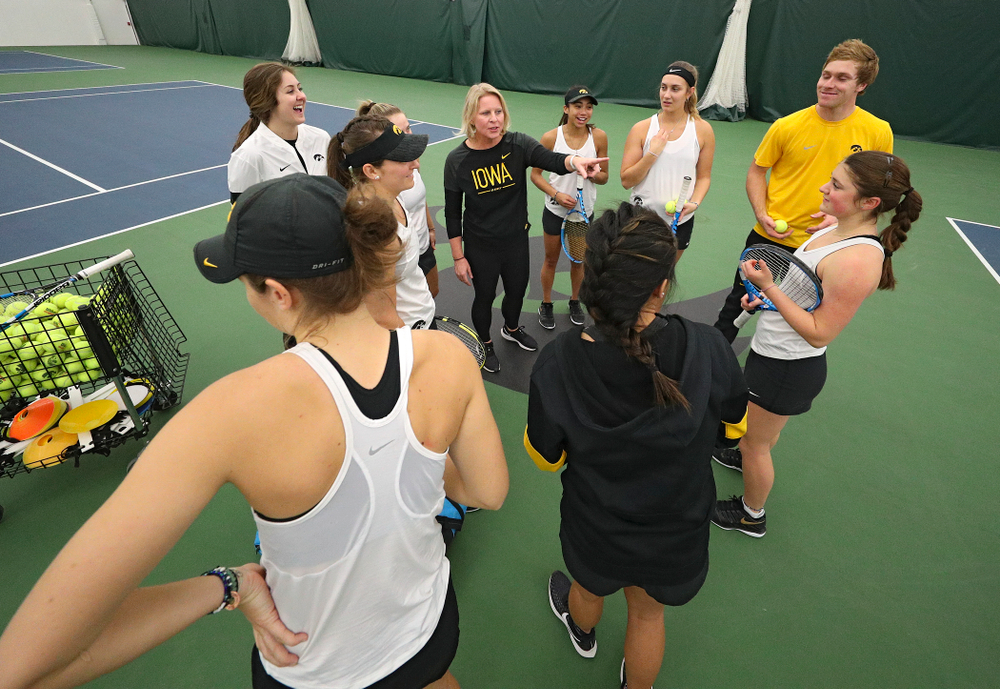 Iowa head coach Sasha Schmid talks to her team before their match at the Hawkeye Tennis and Recreation Complex in Iowa City on Sunday, February 23, 2020. (Stephen Mally/hawkeyesports.com)