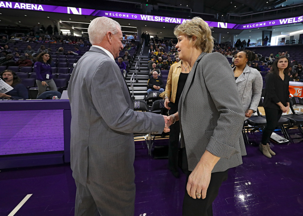 Northwestern Wildcats head coach Joe McKeown shakes hands with Iowa Hawkeyes head coach Lisa Bluder before their game at Welsh-Ryan Arena in Evanston, Ill. on Sunday, January 5, 2020. (Stephen Mally/hawkeyesports.com)