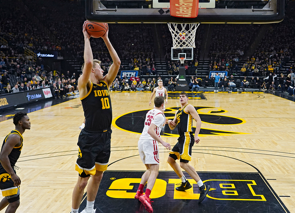 Iowa Hawkeyes guard Joe Wieskamp (10) pulls in a rebound during the second half of their game at Carver-Hawkeye Arena in Iowa City on Monday, January 27, 2020. (Stephen Mally/hawkeyesports.com)