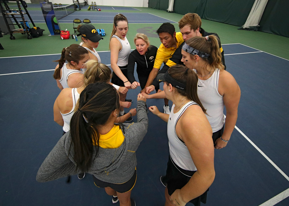 The Hawkeyes huddle before their match at the Hawkeye Tennis and Recreation Complex in Iowa City on Sunday, February 16, 2020. (Stephen Mally/hawkeyesports.com)