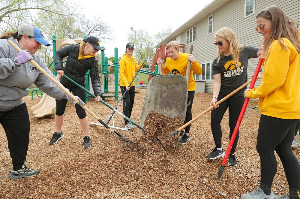 Iowa field hockey players re-mulch the playground at the HACAP Coral Ridge Head Start Center during the 21st annual ISAAC Hawkeye Day of Caring in Coralville on Sunday, Apr. 28, 2019. (Stephen Mally/hawkeyesports.com)
