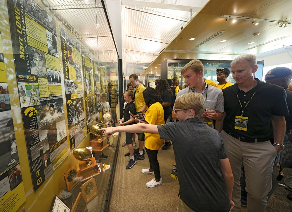 2019 University of Iowa Athletics Hall of Fame inductee Marc Long looks at his exhibit with his family after it was unveiled at the University of Iowa Athletics Hall of Fame in Iowa City on Friday, Aug 30, 2019. (Stephen Mally/hawkeyesports.com)