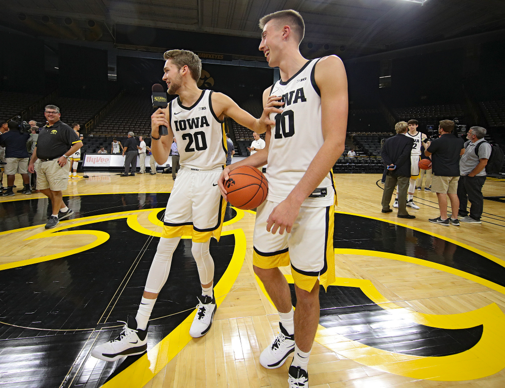 Iowa Hawkeyes forward Riley Till (20) laughs and pushes guard Joe Wieskamp (10) away after asking him a question during Iowa Men's Basketball Media Day at Carver-Hawkeye Arena in Iowa City on Wednesday, Oct 9, 2019. (Stephen Mally/hawkeyesports.com)