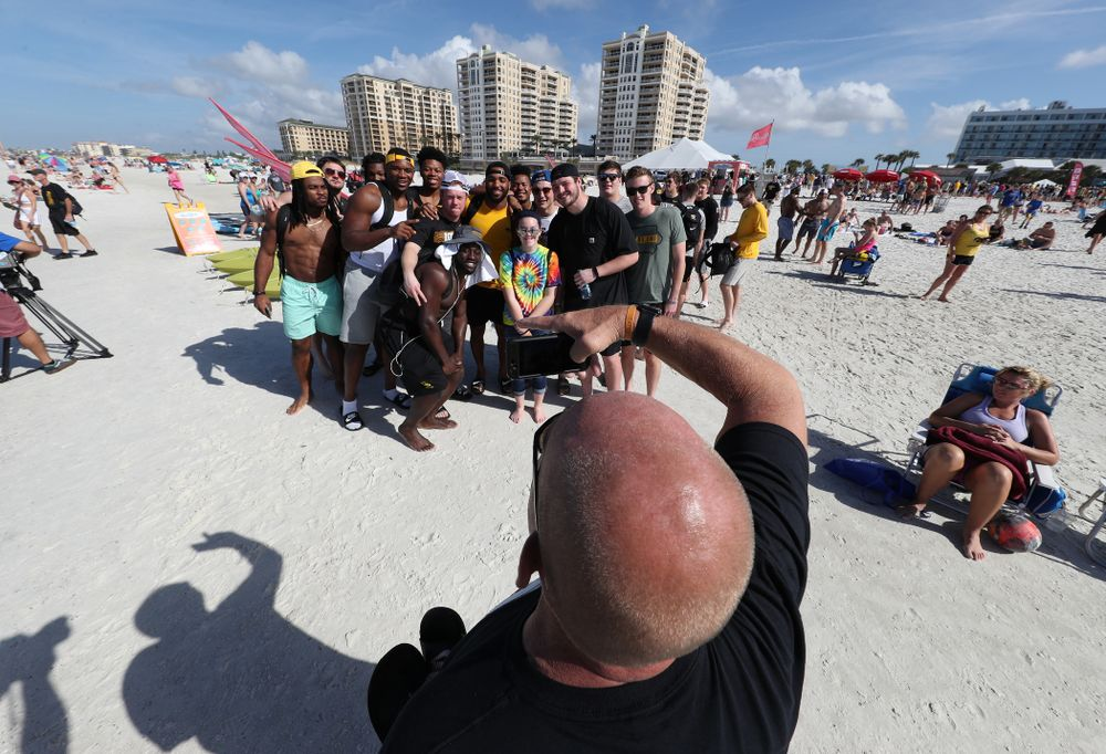 The Iowa Hawkeyes take photo with fans during the Outback Bowl Beach Day Sunday, December 30, 2018 at Clearwater Beach. (Brian Ray/hawkeyesports.com)