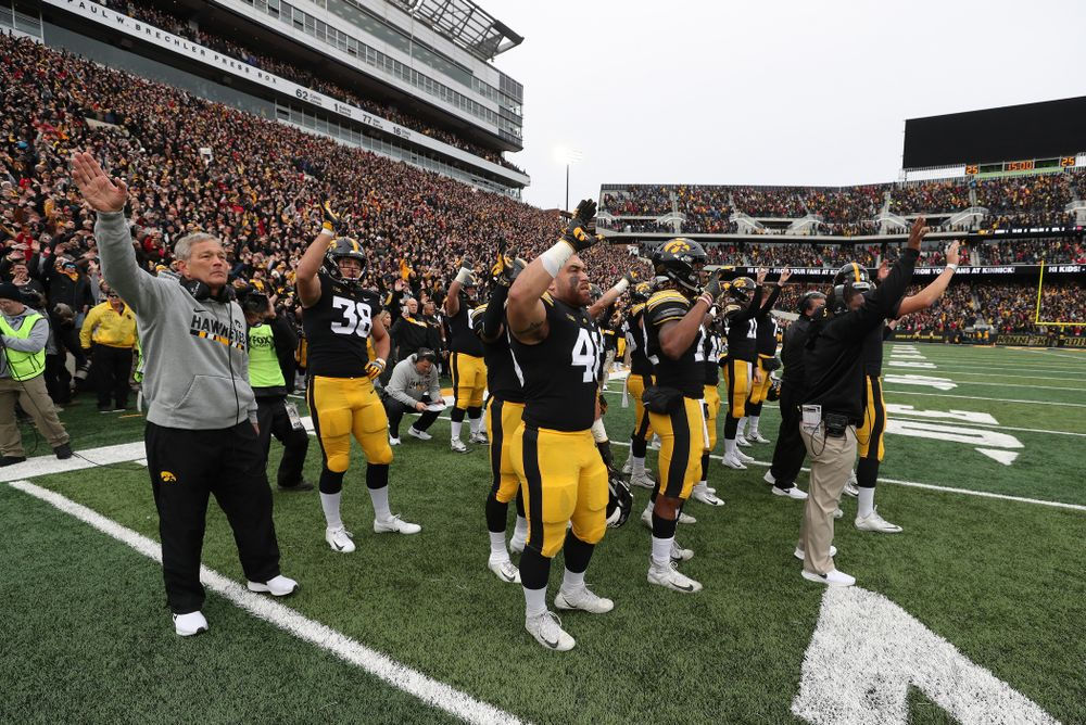 The Iowa Hawkeyes wave to the kids in the Stead Family Children's Hospital at the end of the first quarter of their game against the Nebraska Cornhuskers Friday, November 23, 2018 at Kinnick Stadium. (Brian Ray/hawkeyesports.com)