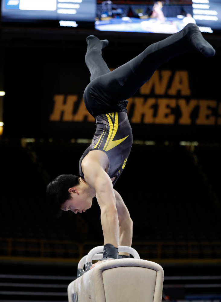 Iowa's Bennet Huang competes on the pommel horse