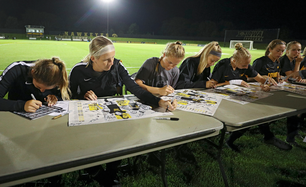 Iowa Hawkeyes players sign autographs after their match against Western Michigan at the Iowa Soccer Complex in Iowa City on Thursday, Aug 22, 2019. (Stephen Mally/hawkeyesports.com)