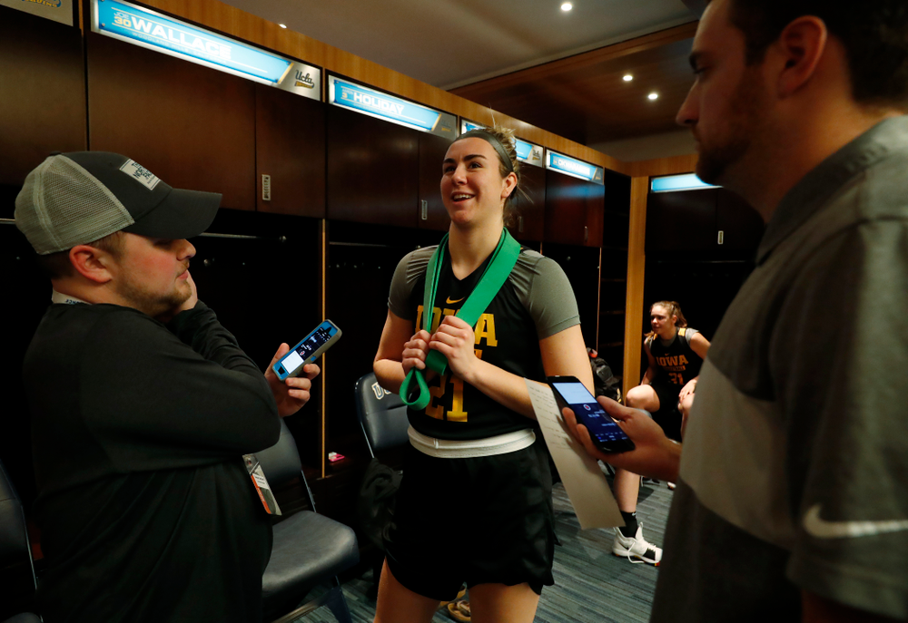 Iowa Hawkeyes forward Hannah Stewart (21) answers questions before practice Friday, March 16, 2018 at Pauley Pavilion on the campus of UCLA. (Brian Ray/hawkeyesports.com)