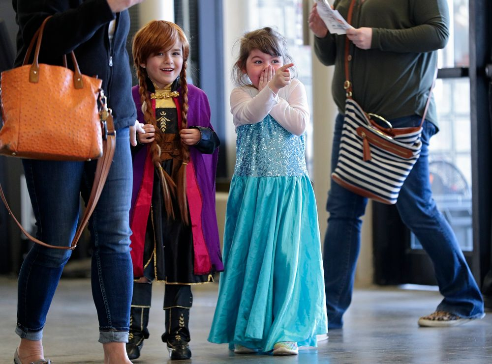 Two young fans react after seeing the princesses on Superhero and Princess Day before the meet at Carver-Hawkeye Arena in Iowa City on Sunday, March 8, 2020. (Stephen Mally/hawkeyesports.com)