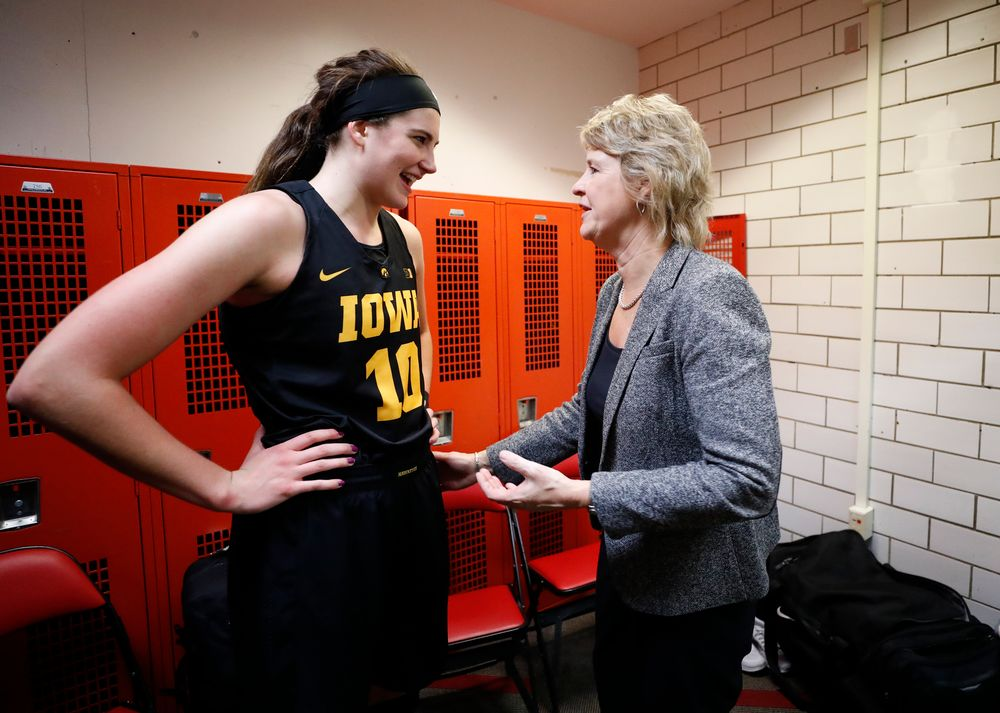 Iowa Hawkeyes forward Megan Gustafson (10) and head coach Lisa Bluder