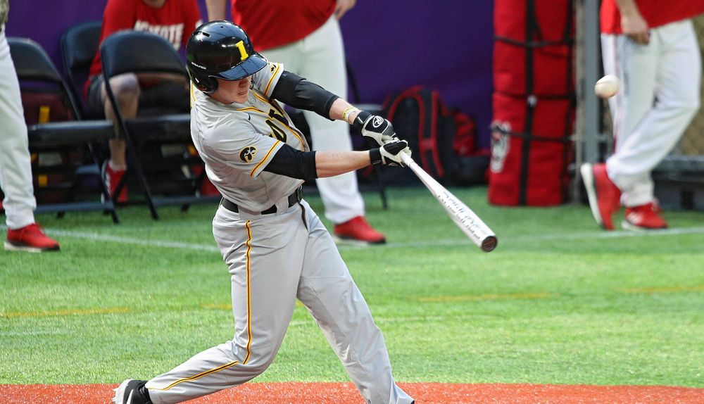 Iowa Hawkeyes utility player Sam Link (3) hits a sacrifice fly to drive in a run during the fifth inning of their CambriaCollegeClassic game at U.S. Bank Stadium in Minneapolis, Minn. on Friday, February 28, 2020. (Stephen Mally/hawkeyesports.com)