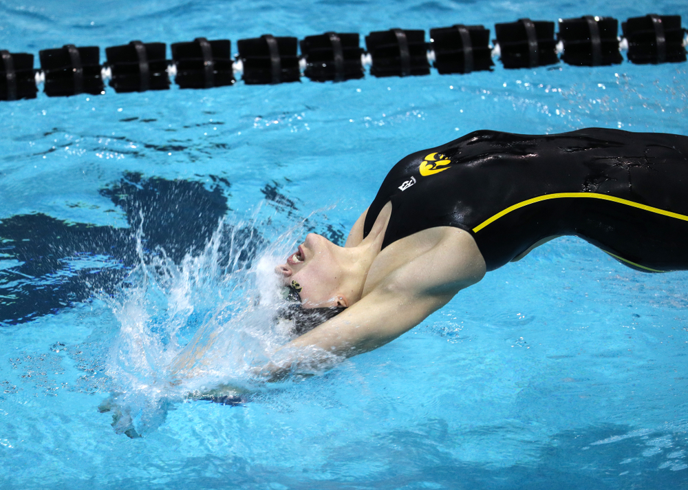 Iowa's Hannah Burvill swims the 100-yard backstroke against the Iowa State Cyclones in the Iowa Corn Cy-Hawk Series Friday, December 7, 2018 at at the Campus Recreation and Wellness Center. (Brian Ray/hawkeyesports.com)