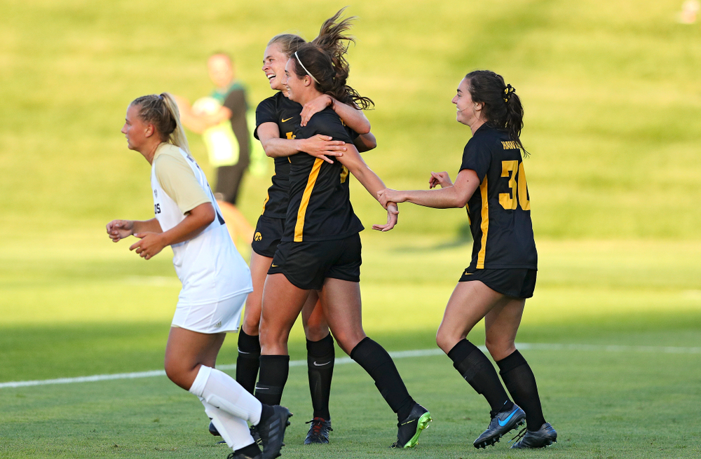 Iowa forward Jenny Cape (left) and forward Devin Burns (right) celebrate with Kaleigh Haus (center) after her goal during the first half of their match against Western Michigan at the Iowa Soccer Complex in Iowa City on Thursday, Aug 22, 2019. (Stephen Mally/hawkeyesports.com)