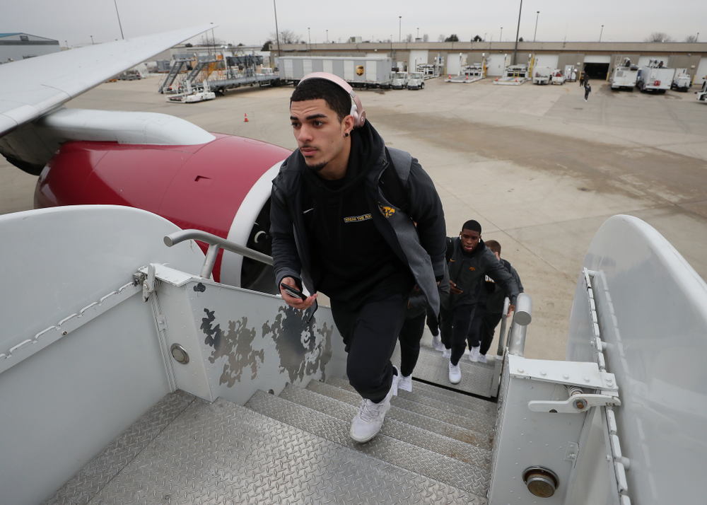 Iowa Hawkeyes defensive back Amani Hooker (27) boards the team plane Wednesday, December 26, 2018 as they travel to Tampa, Florida for the Outback Bowl. (Brian Ray/hawkeyesports.com)