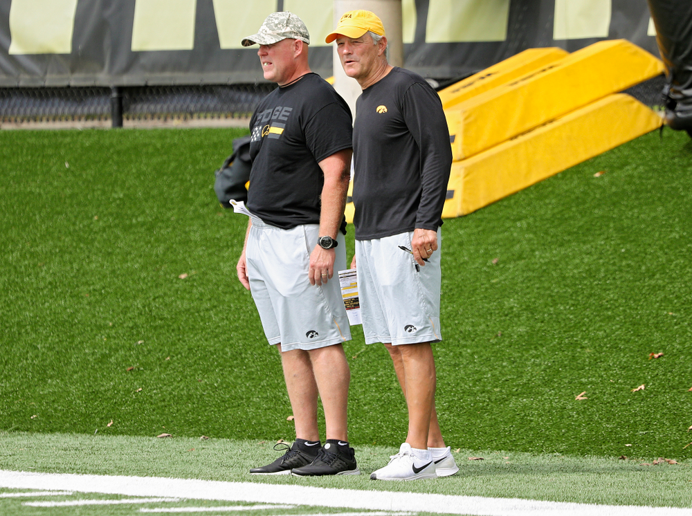 Iowa Hawkeyes strength and conditioning coordinator Chris Doyle and head coach Kirk Ferentz look on during Fall Camp Practice No. 10 at the Hansen Football Performance Center in Iowa City on Tuesday, Aug 13, 2019. (Stephen Mally/hawkeyesports.com)
