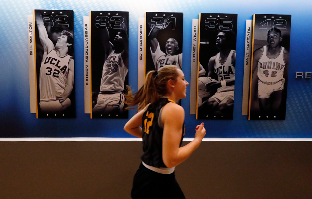 The Iowa Hawkeyes warmup before practice Friday, March 16, 2018 in the hallways of Pauley Pavilion on the campus of UCLA. (Brian Ray/hawkeyesports.com)