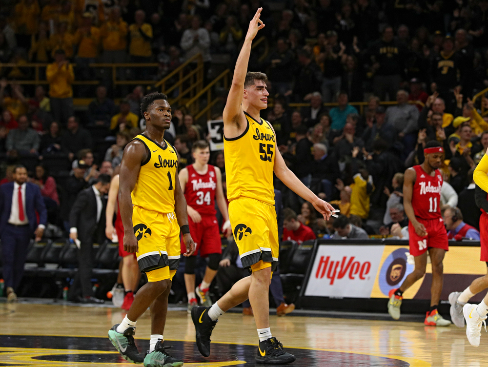 Iowa Hawkeyes center Luka Garza (55) holds up three fingers after guard CJ Fredrick (not pictured) made a 3-pointer to close out the first half of their game at Carver-Hawkeye Arena in Iowa City on Saturday, February 8, 2020. (Stephen Mally/hawkeyesports.com)