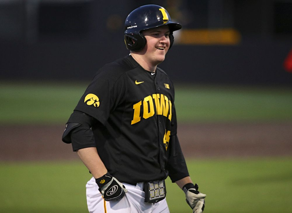 Iowa first baseman Peyton Williams (45) smiles after hitting a triple during the sixth inning of their game at Duane Banks Field in Iowa City on Tuesday, March 3, 2020. (Stephen Mally/hawkeyesports.com)