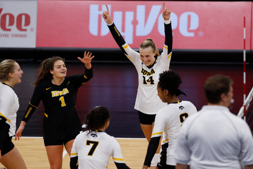 Iowa Hawkeyes outside hitter Cali Hoye (14) and defensive specialist Molly Kelly (1) against Eastern Illinois Sunday, September 9, 2018 at Carver-Hawkeye Arena. (Brian Ray/hawkeyesports.com)