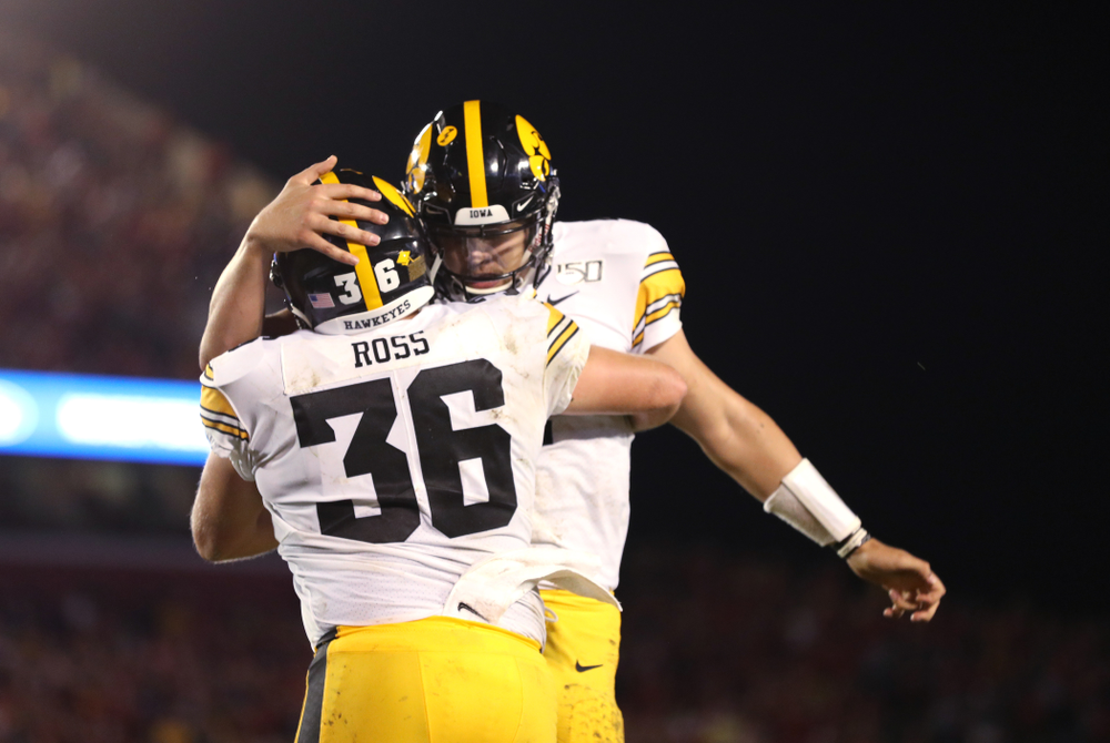 Iowa Hawkeyes quarterback Nate Stanley (4) celebrates with fullback Brady Ross (36) after scoring  against the Iowa State Cyclones Saturday, September 14, 2019 in Ames, Iowa. (Brian Ray/hawkeyesports.com)