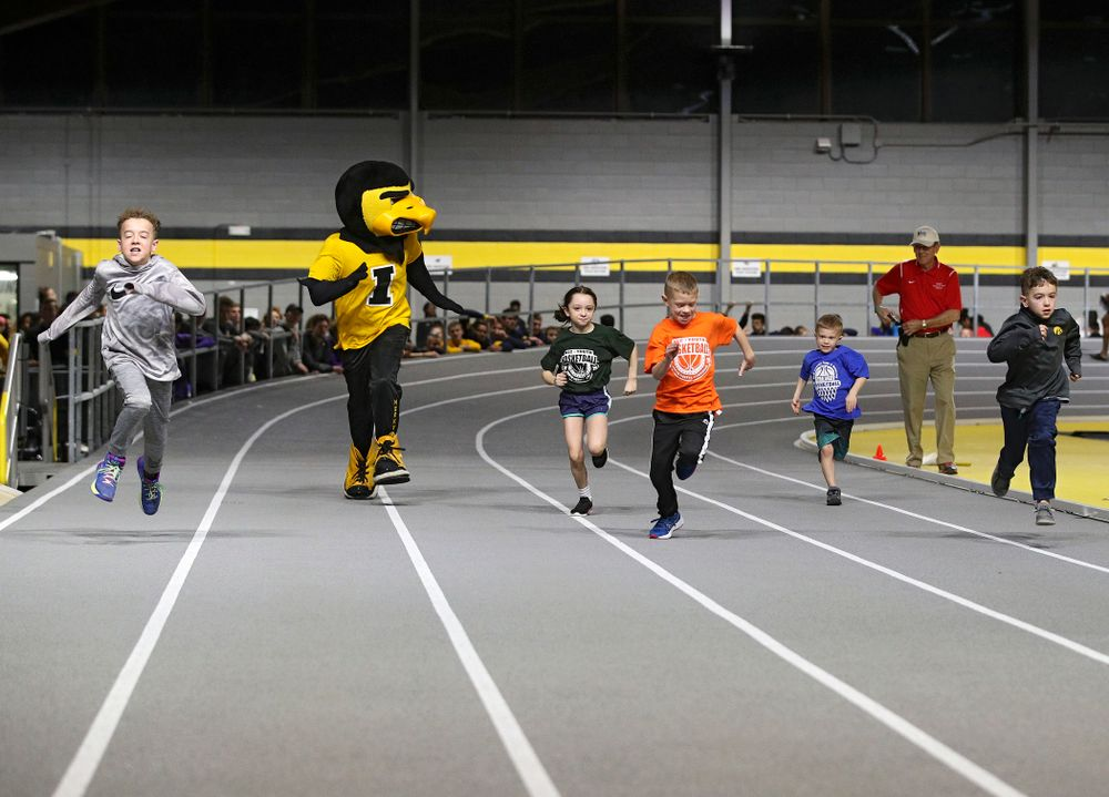 Young fan participate in the Herky Kid's Race at the Black and Gold Invite at the Recreation Building in Iowa City on Saturday, February 1, 2020. (Stephen Mally/hawkeyesports.com)