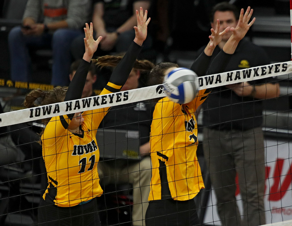 Iowa's Blythe Rients (11) blocks a shot during their match at Carver-Hawkeye Arena in Iowa City on Sunday, Oct 20, 2019. (Stephen Mally/hawkeyesports.com)