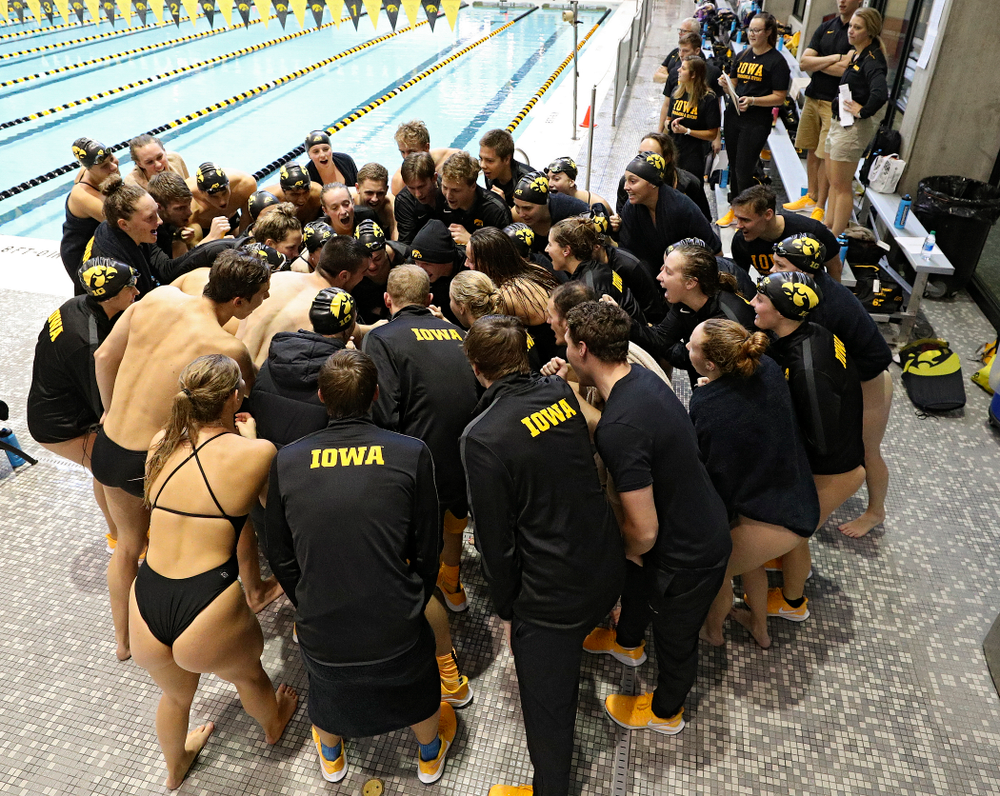 The Iowa Hawkeyes huddle before their meet against Michigan State and Northern Iowa at the Campus Recreation and Wellness Center in Iowa City on Friday, Oct 4, 2019. (Stephen Mally/hawkeyesports.com)