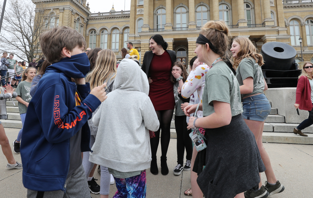 Iowa's Megan Gustafson takes photos with a group of students on a field trip as she leaves the Iowa State Capitol Wednesday, April 24, 2019 in Des Moines. (Brian Ray/hawkeyesports.com)