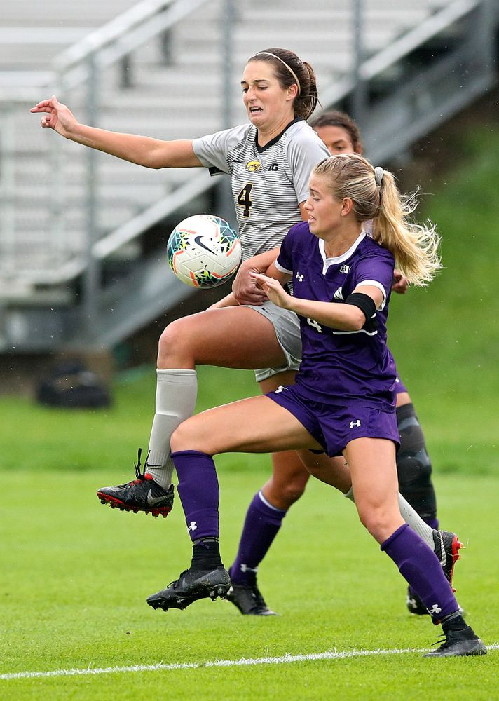 Iowa forward Kaleigh Haus (4) battles for position on the ball during the first half of their match at the Iowa Soccer Complex in Iowa City on Sunday, Sep 29, 2019. (Stephen Mally/hawkeyesports.com)