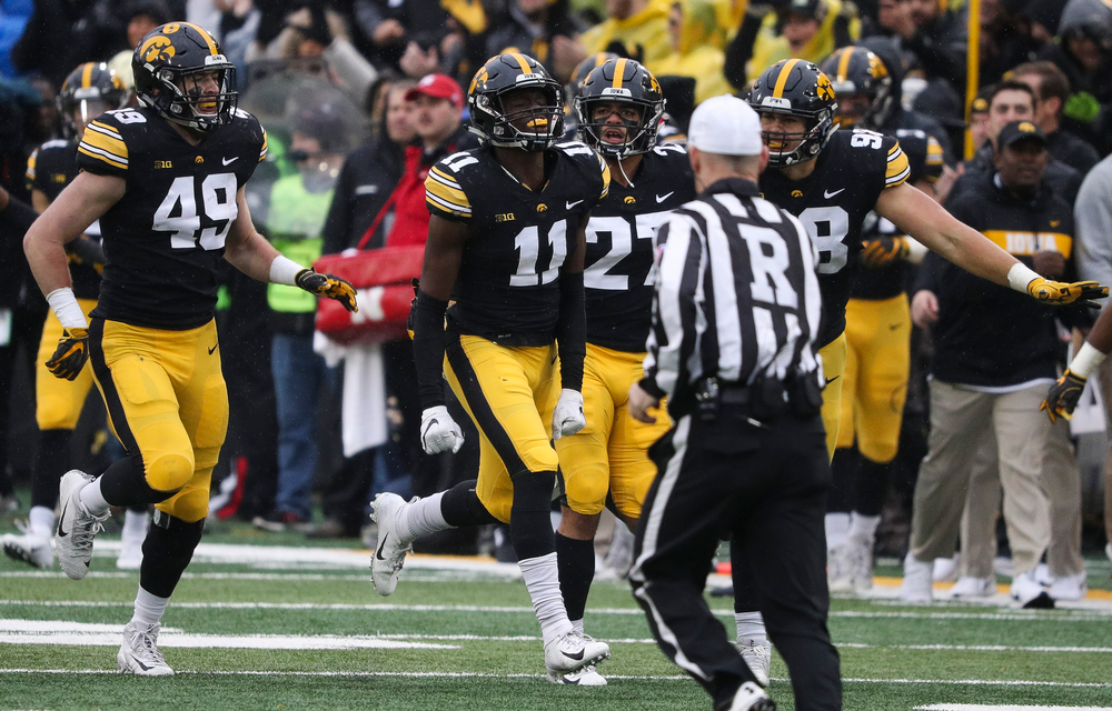 Iowa Hawkeyes defensive back Michael Ojemudia (11) celebrates after making an interception during a game against Nebraska at Kinnick Stadium on November 23, 2018. (Tork Mason/hawkeyesports.com)