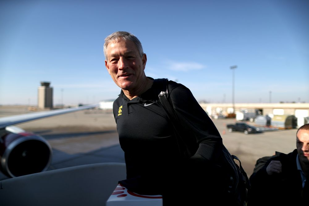 Iowa Hawkeyes head coach Kirk Ferentz boards the team plane at the Eastern Iowa Airport Saturday, December 21, 2019 on the way to San Diego, CA for the Holiday Bowl. (Brian Ray/hawkeyesports.com)