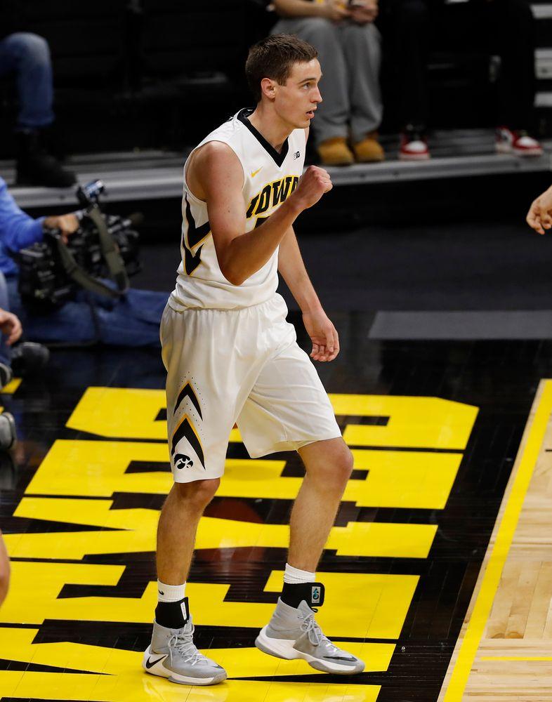 Iowa Hawkeyes forward Nicholas Baer (51)