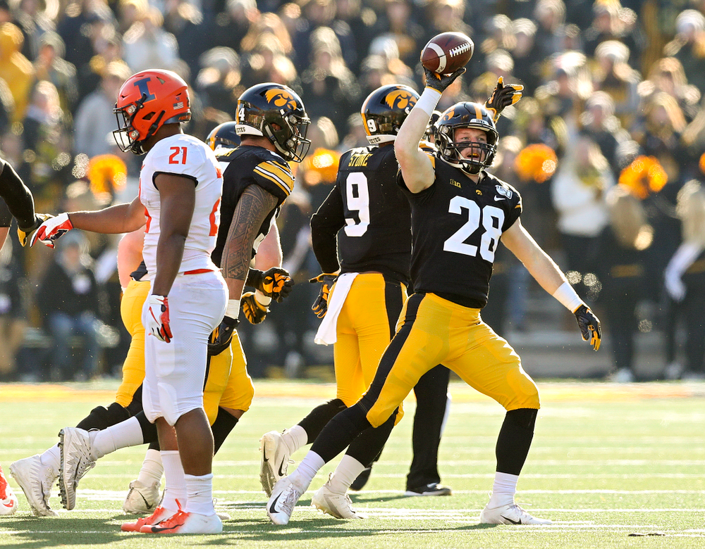 Iowa Hawkeyes defensive back Jack Koerner (28) holds up the ball after he recovered a fumble during the fourth quarter of their game at Kinnick Stadium in Iowa City on Saturday, Nov 23, 2019. (Stephen Mally/hawkeyesports.com)