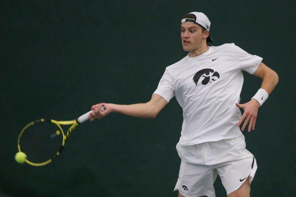 Iowa's Joe Tyler returns a hit during the Iowa men's tennis meet vs Nebraska on Sunday, March 1, 2020 at the Hawkeye Tennis and Recreation Complex. (Lily Smith/hawkeyesports.com)