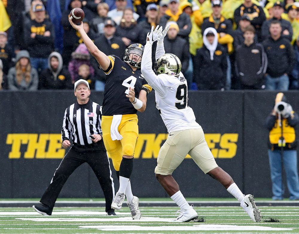 Iowa Hawkeyes quarterback Nate Stanley (4) completes a pass on the run during the third quarter of their game at Kinnick Stadium in Iowa City on Saturday, Oct 19, 2019. (Stephen Mally/hawkeyesports.com)