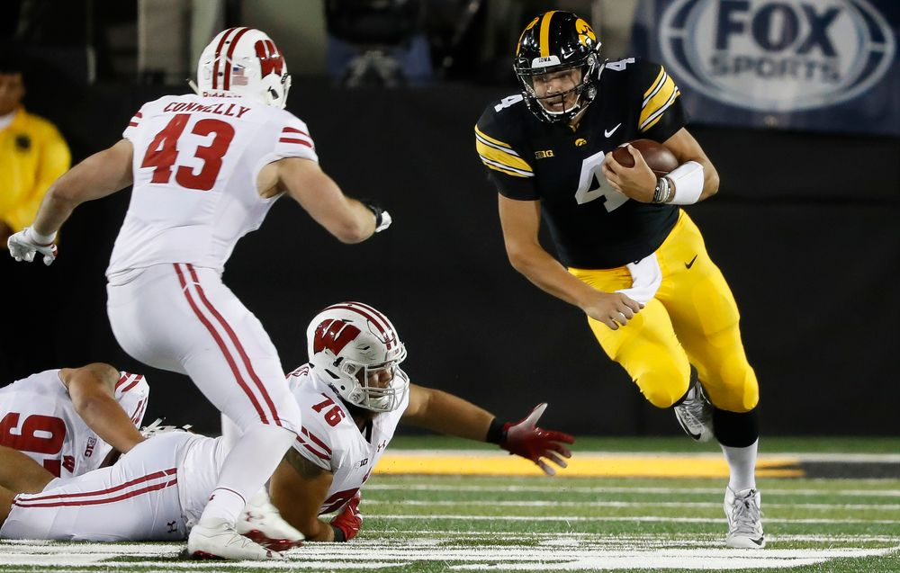 Iowa Hawkeyes quarterback Nate Stanley (4) runs the ball during a game against Wisconsin at Kinnick Stadium on September 22, 2018. (Tork Mason/hawkeyesports.com)
