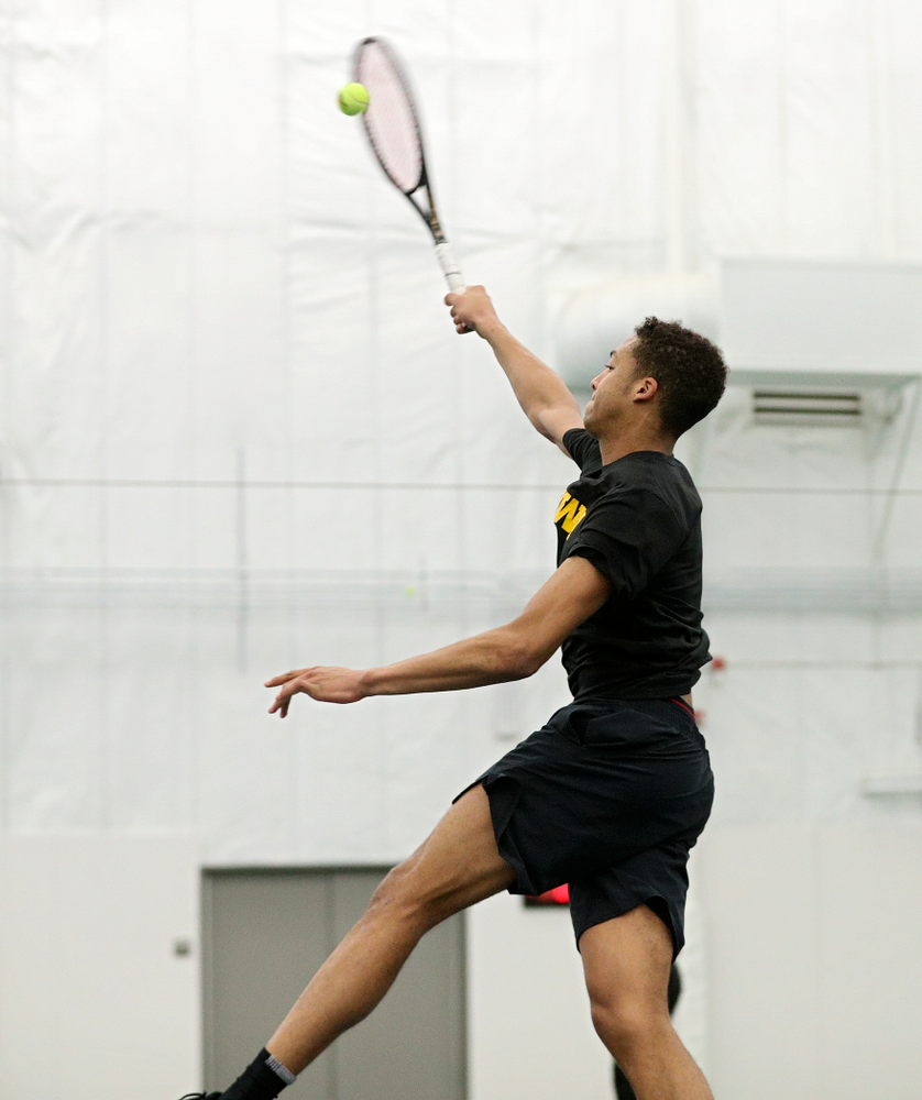 Iowa's Oliver Okonkwo drives home a shot during his singles match at the Hawkeye Tennis and Recreation Complex in Iowa City on Friday, March 6, 2020. (Stephen Mally/hawkeyesports.com)