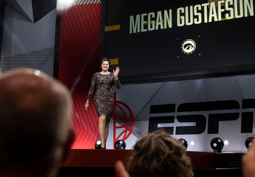 Iowa Hawkeyes forward Megan Gustafson (10) walks across the stage during the ESPN College Basketball Awards show Friday, April 12, 2019 at The Novo at LA Live.  (Brian Ray/hawkeyesports.com)