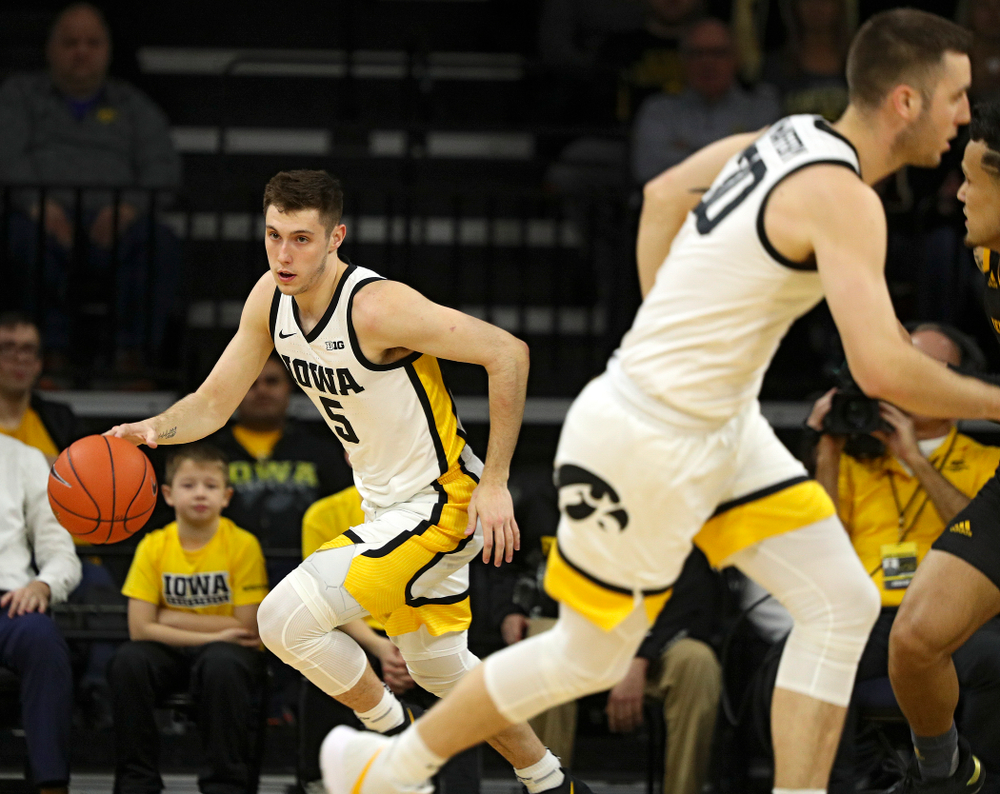 Iowa Hawkeyes guard CJ Fredrick (5) moves with the ball as guard Connor McCaffery (30) heads down court during the first half of their their game at Carver-Hawkeye Arena in Iowa City on Sunday, December 29, 2019. (Stephen Mally/hawkeyesports.com)