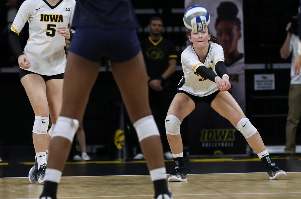 Iowa Hawkeyes defensive specialist Halle Johnston (4) bumps the ball during a match against Penn State at Carver-Hawkeye Arena on November 3, 2018. (Tork Mason/hawkeyesports.com)