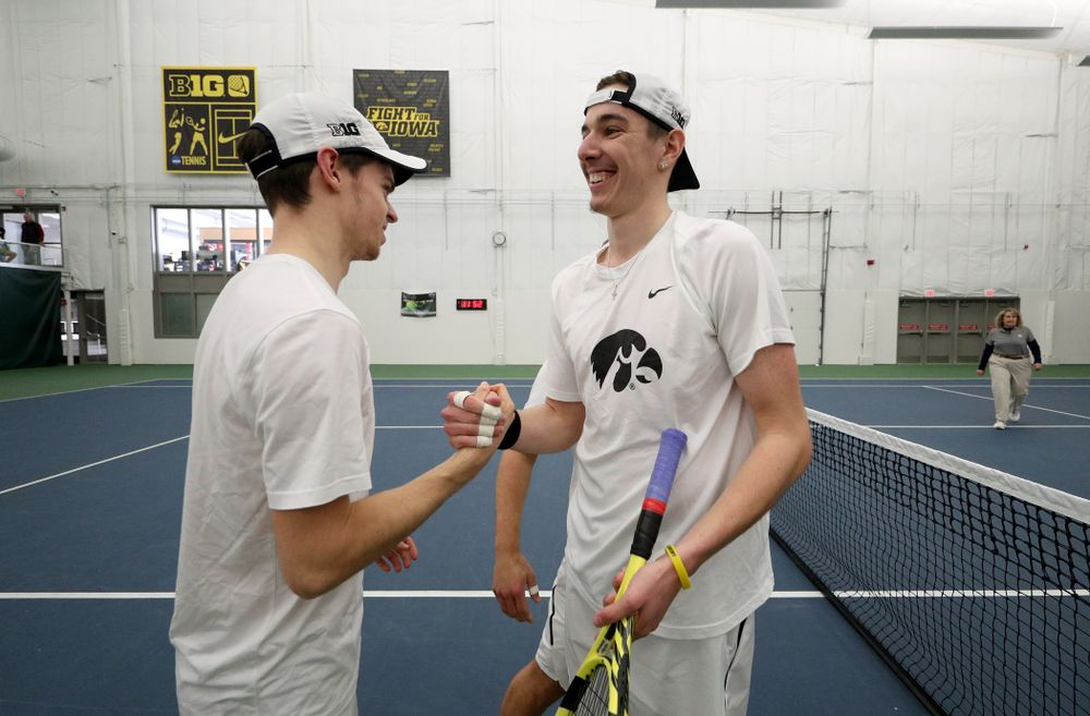 Iowa's Karem Allaf and Nikita Snezhko play a doubles match against Cornell Sunday, March 8, 2020 at the Hawkeye Tennis and Recreation Center. (Brian Ray/hawkeyesports.com)