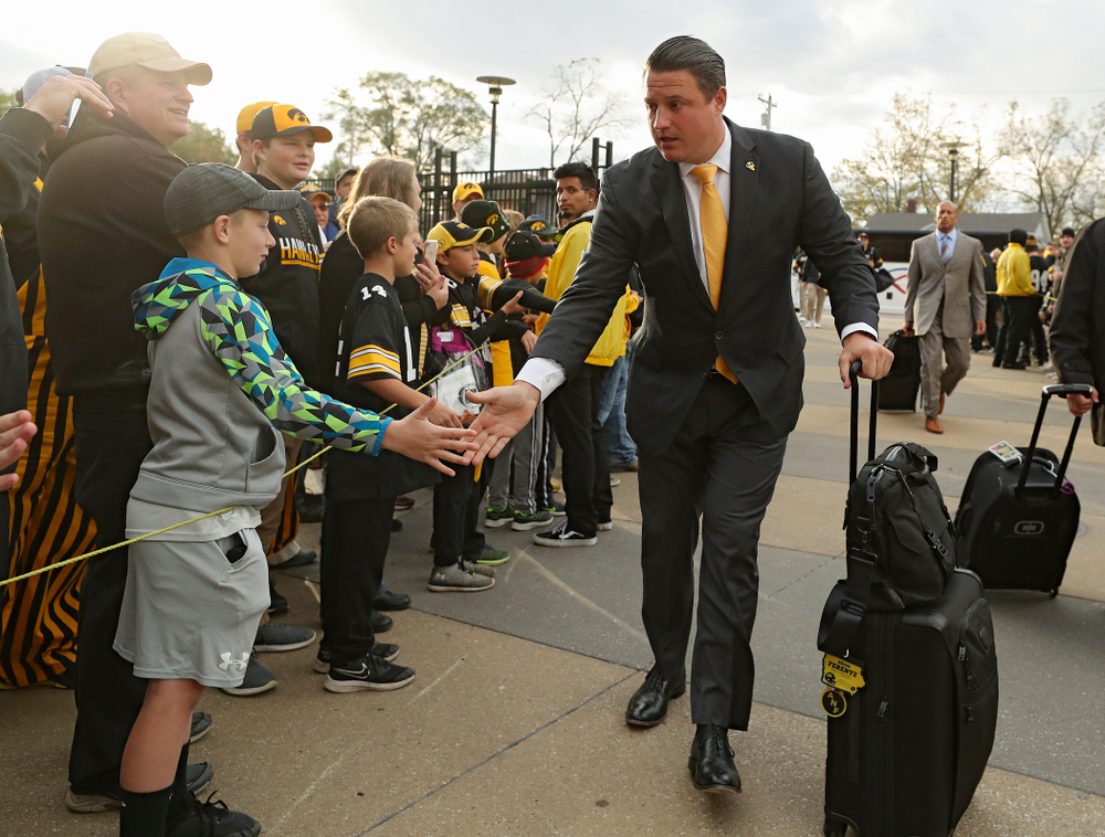 Iowa Hawkeyes offensive coordinator Brian Ferentz greets fans as he arrives with his team before their game at Kinnick Stadium in Iowa City on Saturday, Oct 19, 2019. (Stephen Mally/hawkeyesports.com)