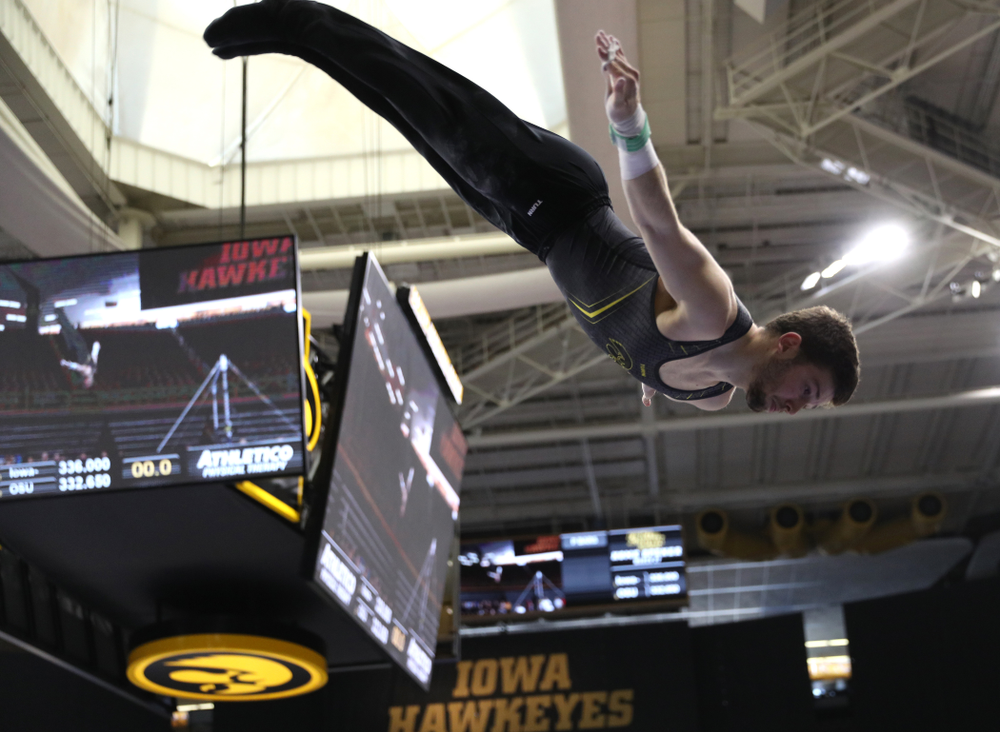 Iowa's Rogelio Vazquez competes on the high bar against the Ohio State Buckeyes Saturday, March 16, 2019 at Carver-Hawkeye Arena.  (Brian Ray/hawkeyesports.com)