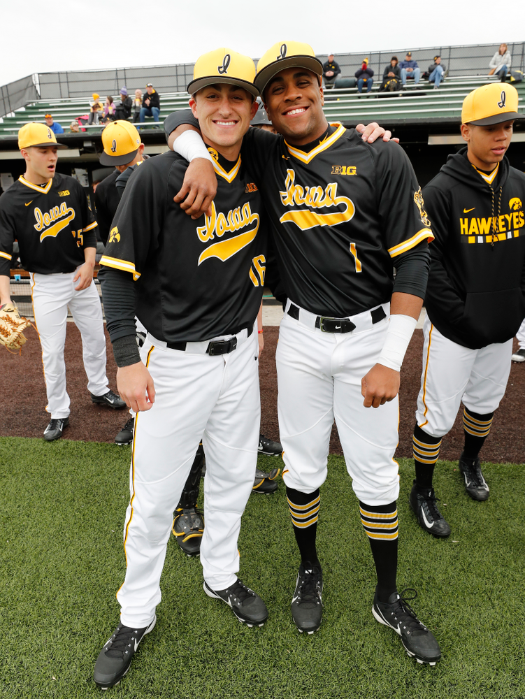 Iowa Hawkeyes infielder Tanner Wetrich (16) and third baseman Lorenzo Elion (1) against the Bradley Braves Wednesday, March 28, 2018 at Duane Banks Field. (Brian Ray/hawkeyesports.com)