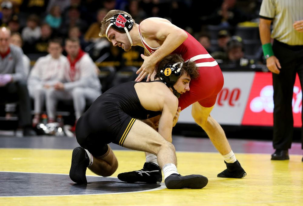 IowaÕs Austin DeSanto wrestles WisconsinÕs  Seth Gross at 133 pounds Sunday, December 1, 2019 at Carver-Hawkeye Arena. DeSanto won the match 6-2. (Brian Ray/hawkeyesports.com)