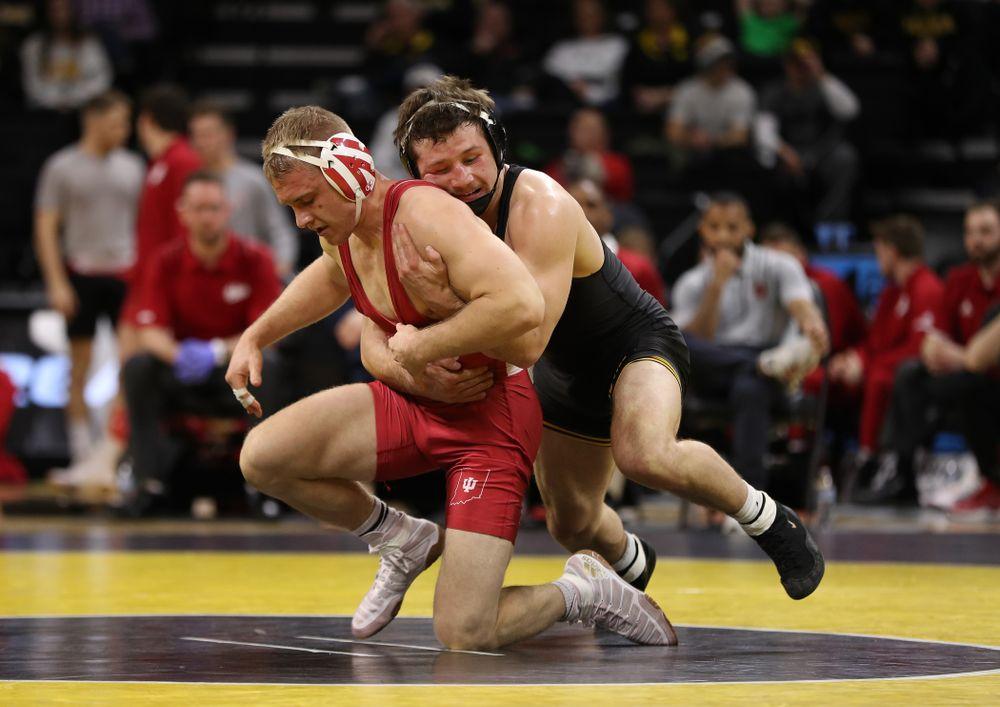 Iowa's Jaren Glosser wrestles Indiana's Jake Danishek at 157 pounds Friday, February 15, 2019 at Carver-Hawkeye Arena. (Brian Ray/hawkeyesports.com)
