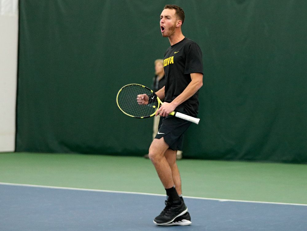 Iowa's Kareem Allaf celebrates a point during his doubles match at the Hawkeye Tennis and Recreation Complex in Iowa City on Thursday, January 16, 2020. (Stephen Mally/hawkeyesports.com)