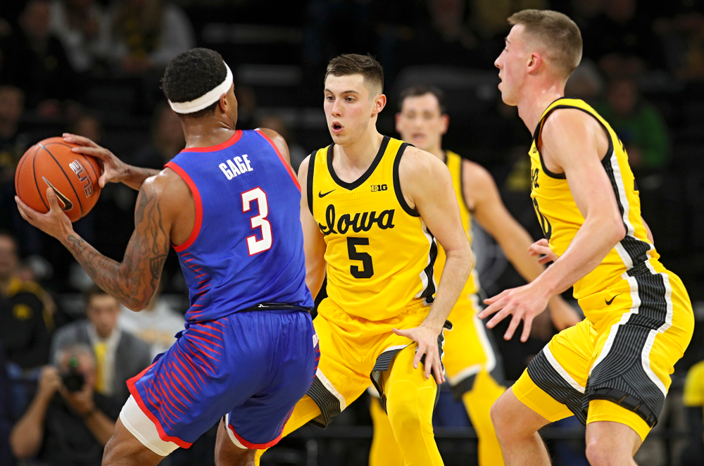 Iowa Hawkeyes guard CJ Fredrick (5) and guard Joe Wieskamp (10) apply pressure during the first half of their game at Carver-Hawkeye Arena in Iowa City on Monday, Nov 11, 2019. (Stephen Mally/hawkeyesports.com)